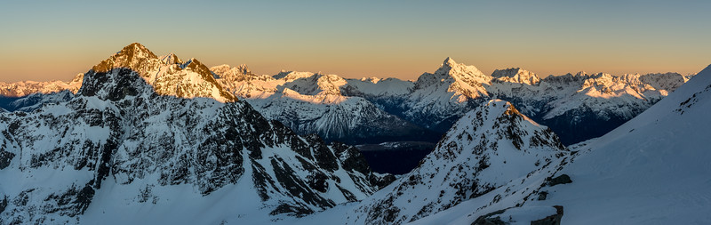 View from the western slopes of Pt 2024m. From left to right are Jean Batten Peak, Flat Top Peak, Ngatimamoe Peak, Pyramid Peak, Mount Charlton, Mount Suter, Mount Christina, Mount Crosscut, Barrier Peak, Marian Peak, Sabre Peak, Adelaide Peak