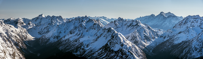 View into the head of Fraser Creek and Kay Creek from Pt 2024m. The prominent peaks on the skyline are, from left to right, Somnus, Unnamed Peak Pt 2117m (Humboldt Mountains), Upper Peak, Mount Earnslaw. Climax Peak and Destiny Peak (Olivines) are on the skyline at centre image.