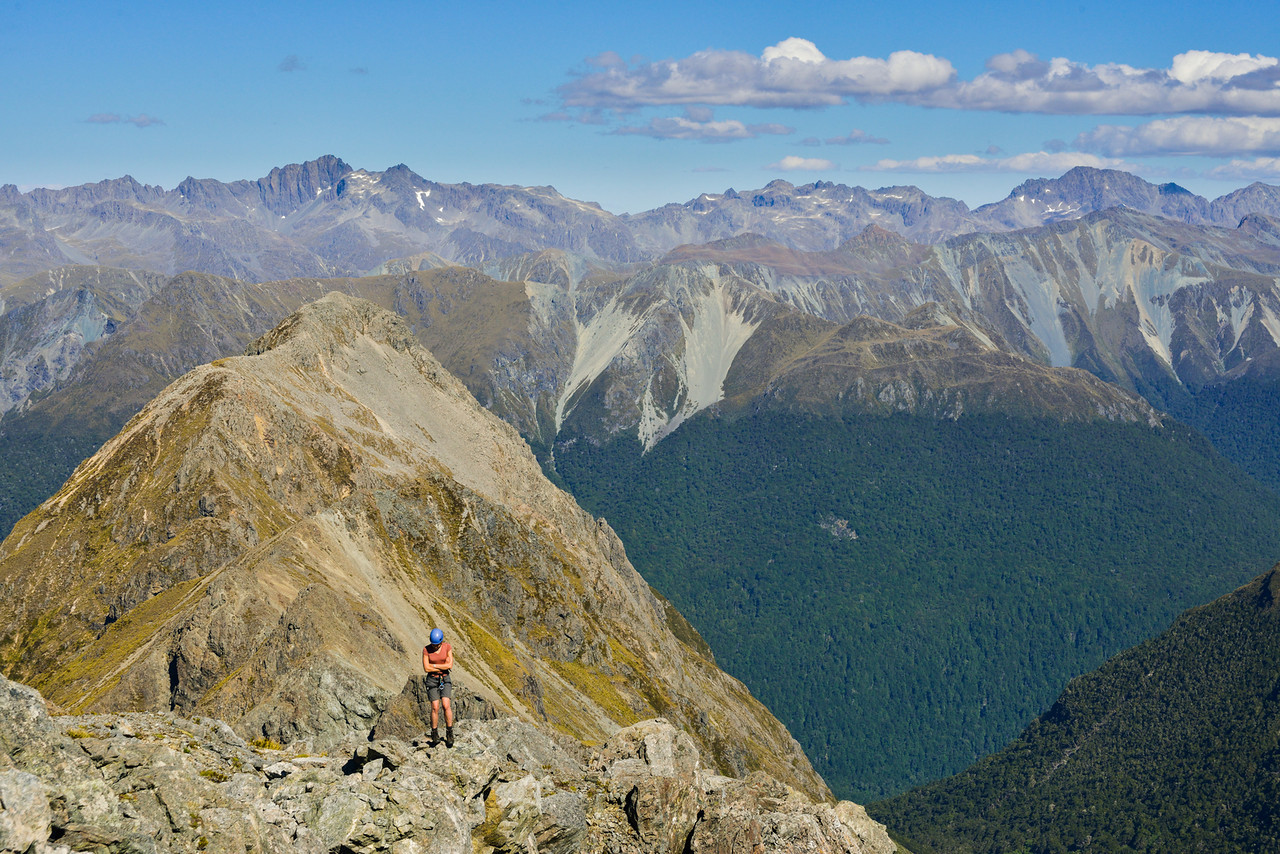 Gwenn on Triton Peak. The Livingstone Mountains are in the back, with the David Peaks (left) and Moffat Peak (right)