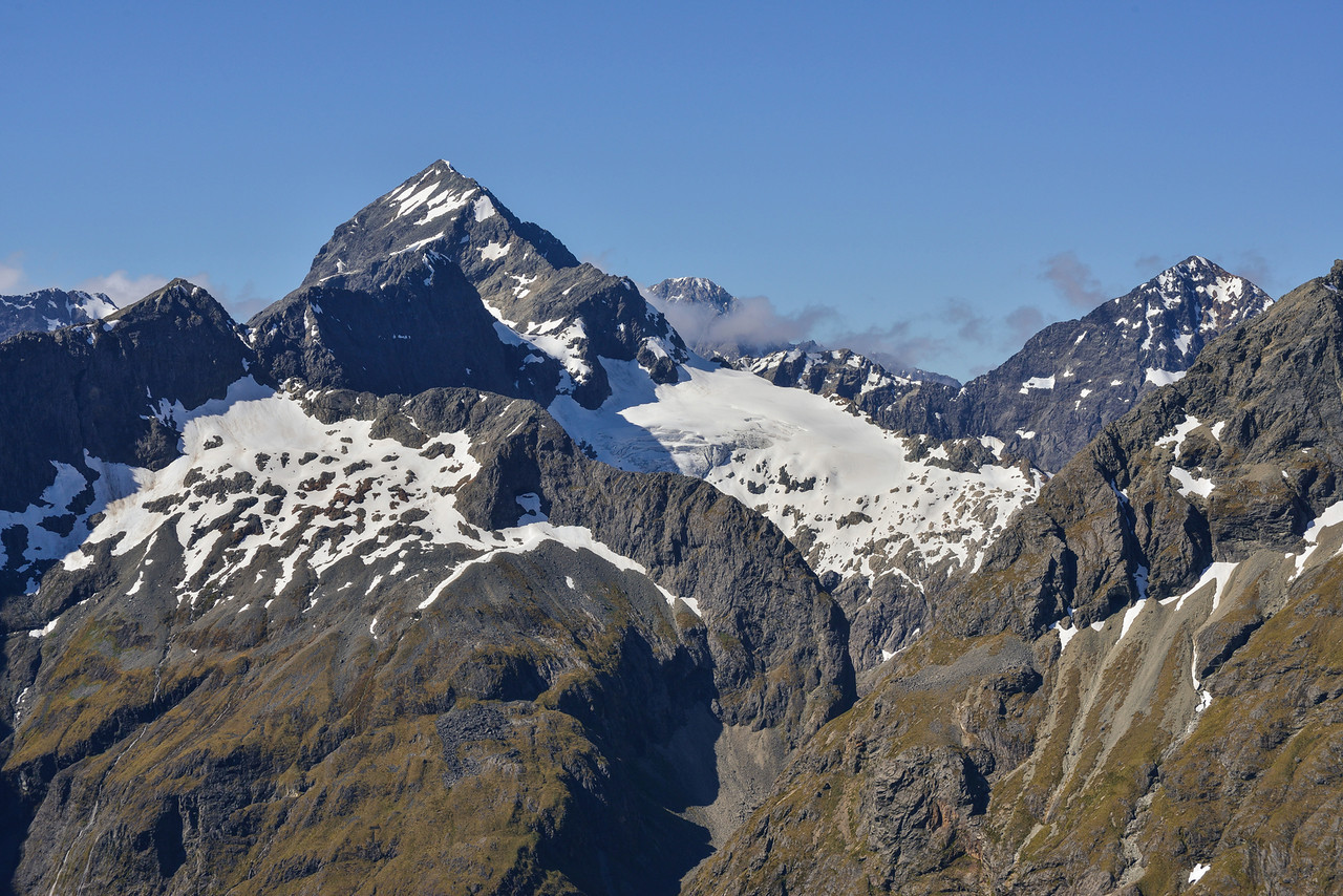 View from Triton Peak, looking north: Flat Top Peak (left), Ngatimamoe Peak (right) and Mt Christina (centre, back). U-Pass is just visible in the foreground, to the right of centre image