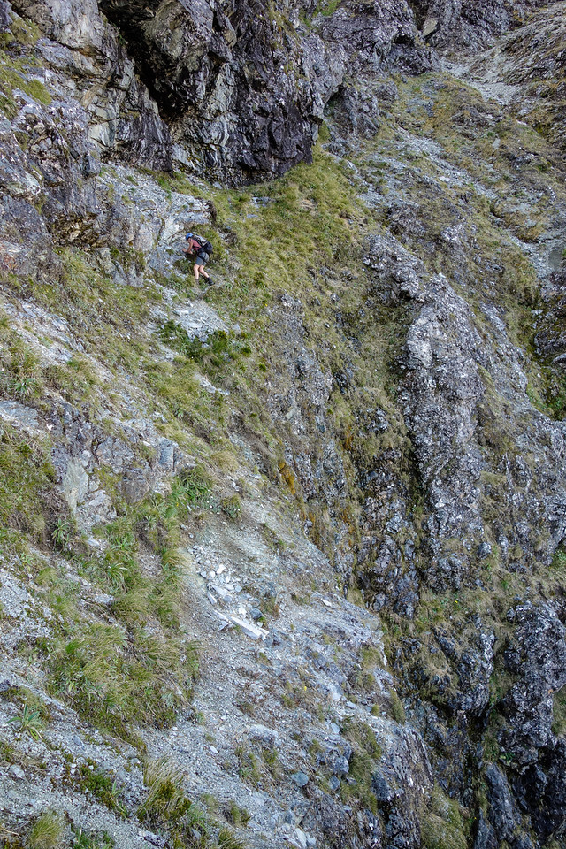 Gwenn sidling the exposed ramp on Triton Peak