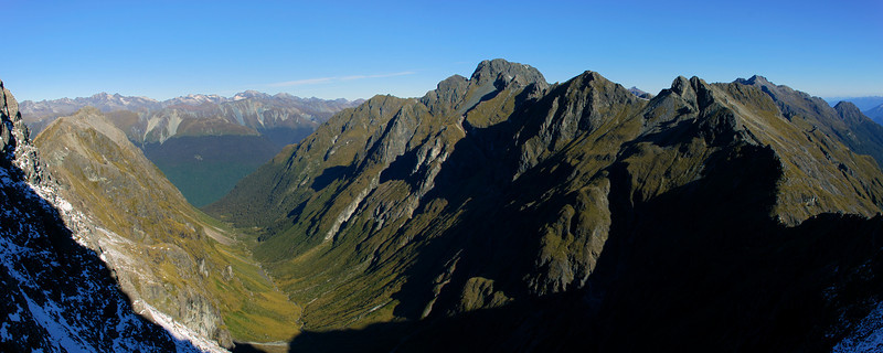 Looking down Waterfall Creek from the south ridge of Triton Peak. The Livingstone Mountains are on the horizon in the left half of the image. The Disappearing Peaks are at centre image, while Skelmorlie Peak is on the far right.