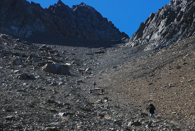 Ascending endless scree slopes towards Belfry Peak