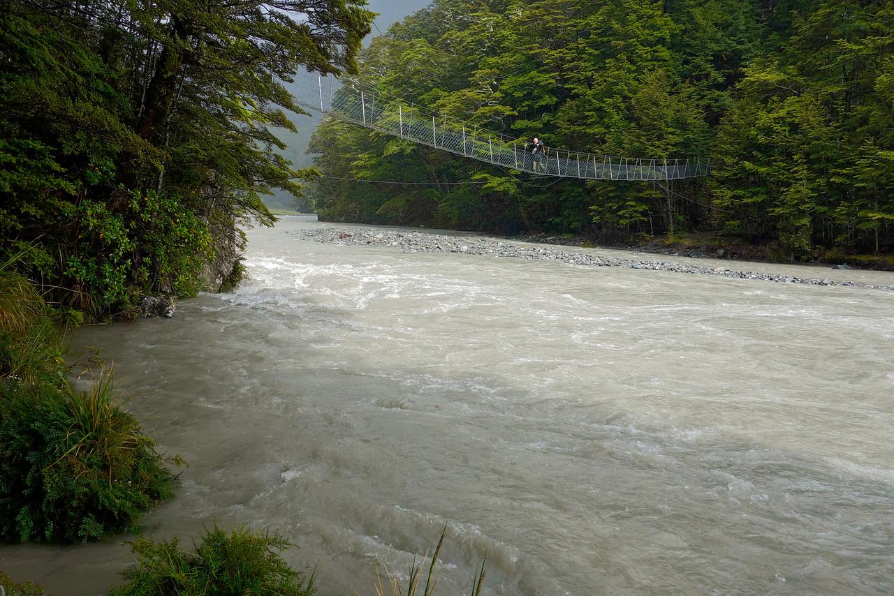 Crossing the swingbridge over the Huxley River