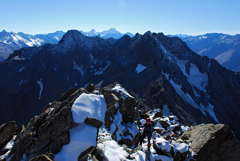 Emma on the north ridge of Mt Glencairn. Mt Glenisla at centre image, Mt Sefton and Mt Cook on the horizon