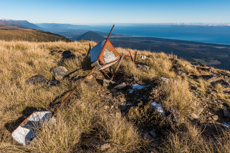 Old trig on Mount Smith, Mataketake Range. The West Coast and Jackson Bay in the background.