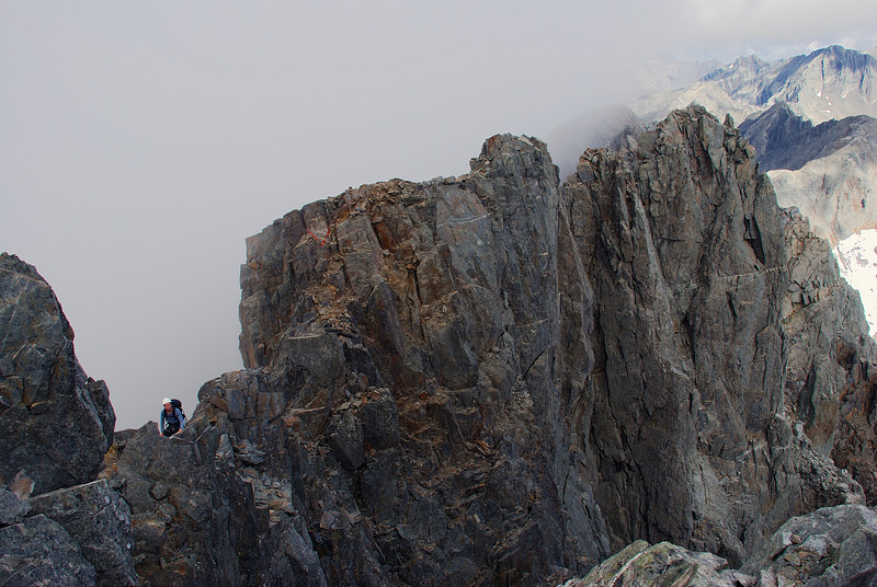 Looking back from the top of Mount Strauchon. James negotiates the narrow summit ridge.