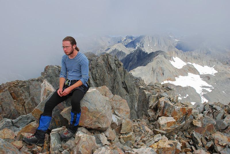 James on the summit of Mount Strauchon
