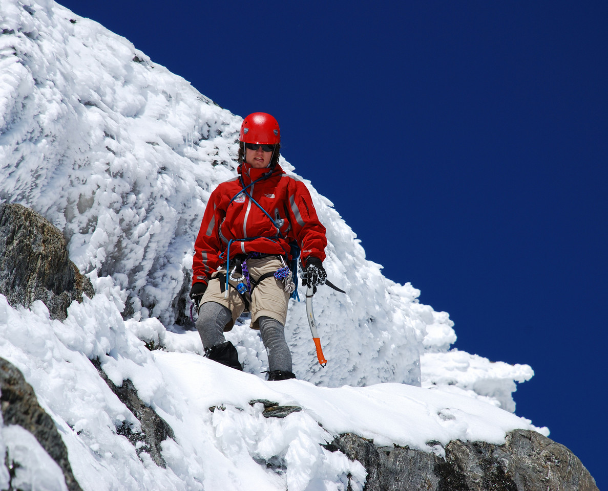 Alexis traversing under the notch on the west ridge of Mt McCullaugh