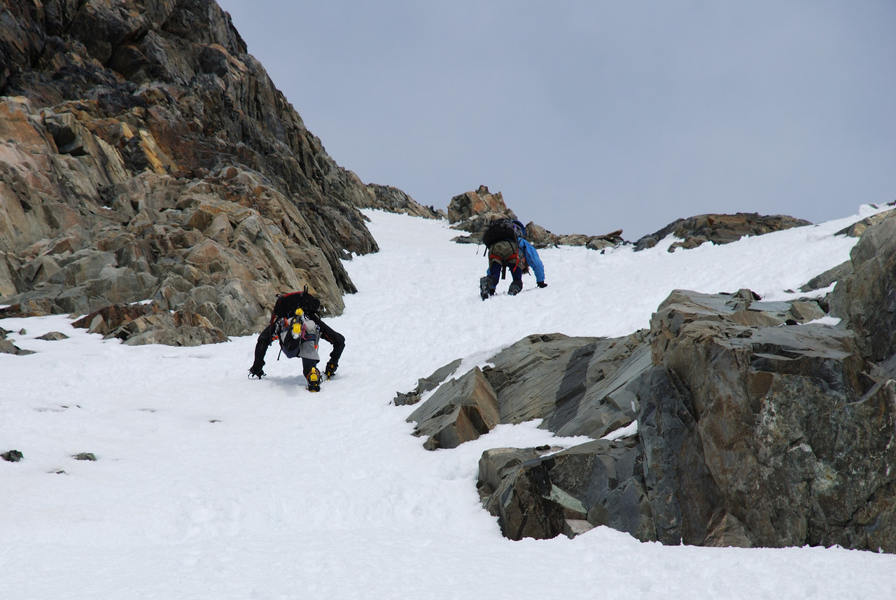 Descending the summit pyramid of Mt Huxley