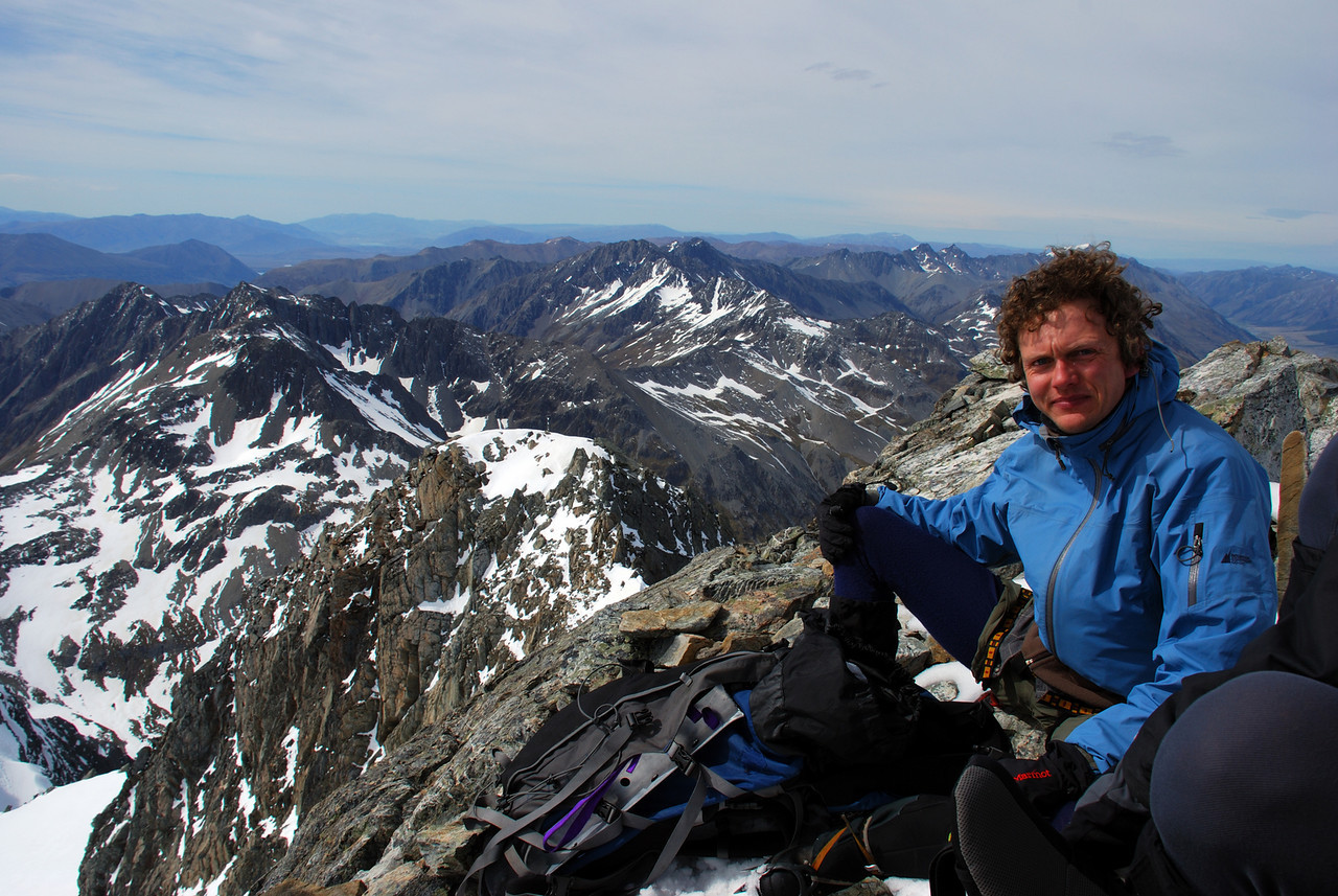 George on the summit of Mt Huxley. The Barrier Range behind.
