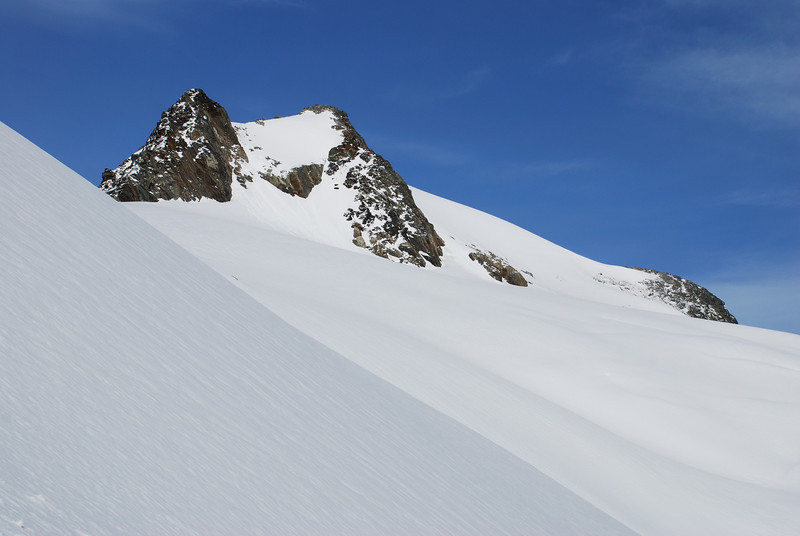 The summit pyramid of Mt Huxley. We climbed around the back (right), then descended the steep snow slope on the left