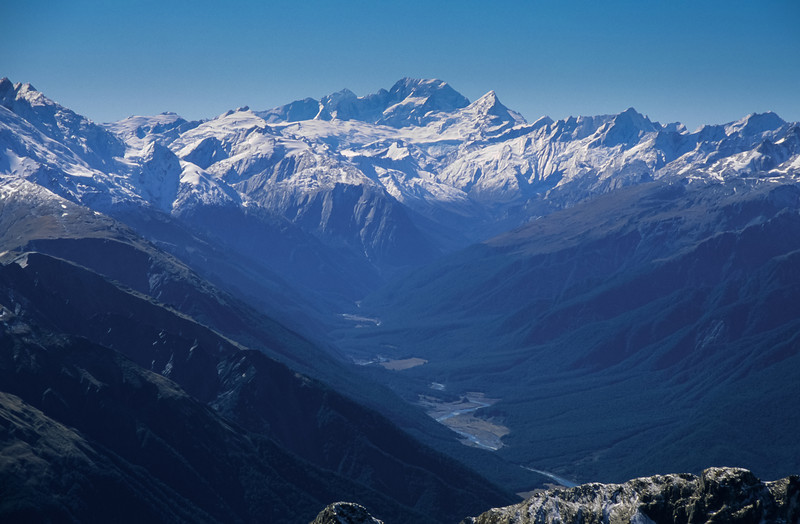 Aoraki/Mount Cook and Mount Sefton dominate the scene above the Landsborough River. View from Mount Napoleon