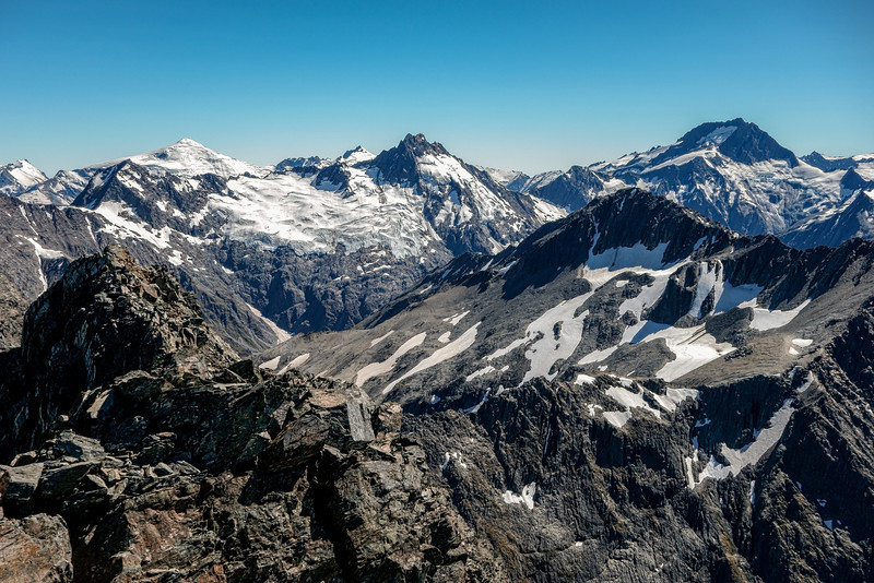 Panorama from the summit of Taiaha Peak. From left to right are Mt Dechen, Mt Strachan (back), Mt Jackson (front) and Mt Ward. Gillies Peak is in the foreground, just left of Mt Ward
