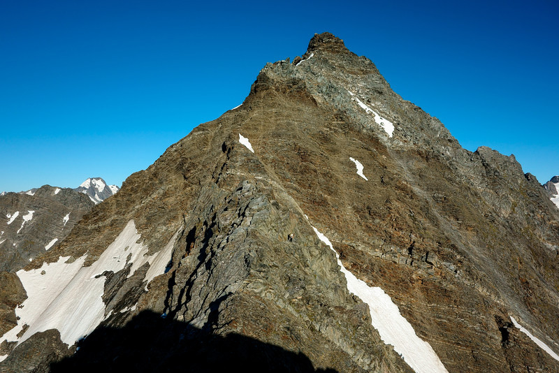 James on the first section of Taiaha Peak's east ridge as seen from pt 2018m. The prominent peak at centre image is only the top of the first steep step, less than half-way to the summit