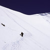 Descending the snow-field at the top of Sebastopol Ridge