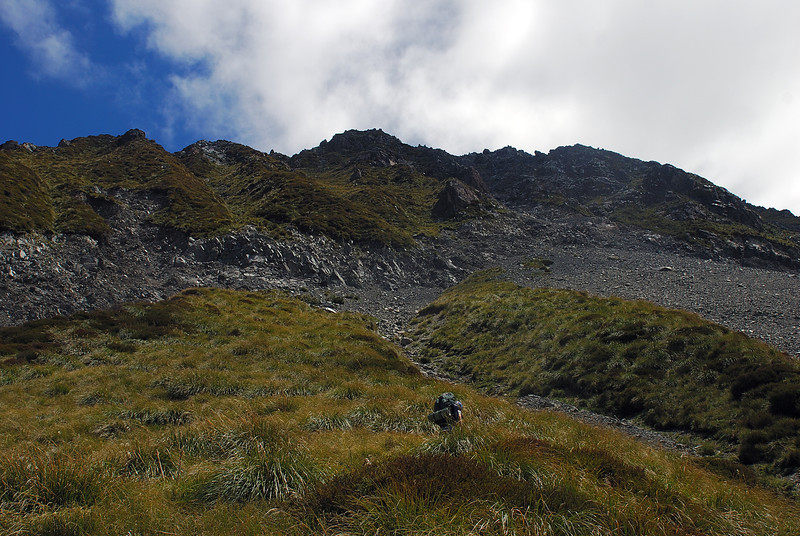 Ascending the slopes towards Haast Ridge. The eroded band above is one of the most unpleasant sections of the climb