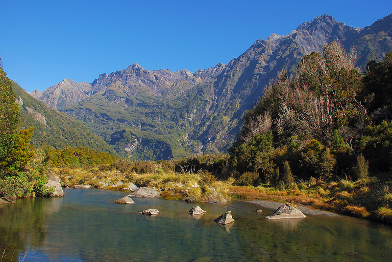 The Bare Rocky Range above Cassel Flat, Karangarua River. Jagged Spur on the left; McGloin Peak right