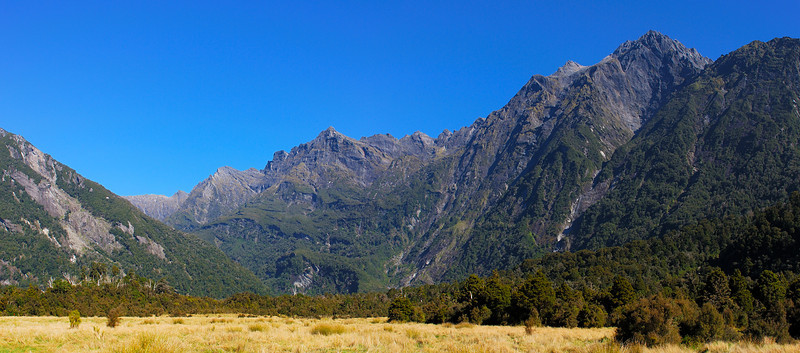 Cassel Flat and the Bare Rocky Range, Karangarua River. Jagged Spur is to the left of centre image; McGloin Peak on the far right