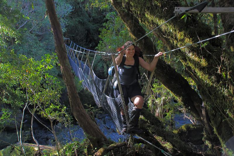 Crossing the 3-wire bridge over Regina Creek, Karangarua River