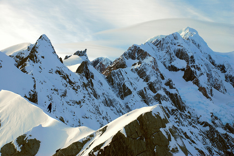 Jennifer on the summit ridge of Crozet Peak. In the background from left to right are Mt Du Fresne, Big Mac, Torres Peak, Mt Tasman