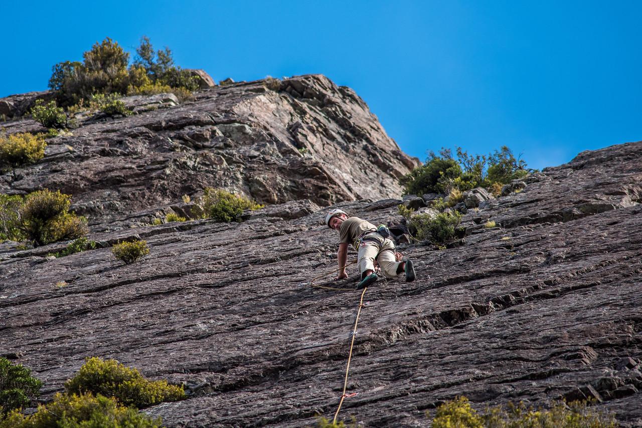 Max rock climbing on red arete, Sebastopol Bluffs.
