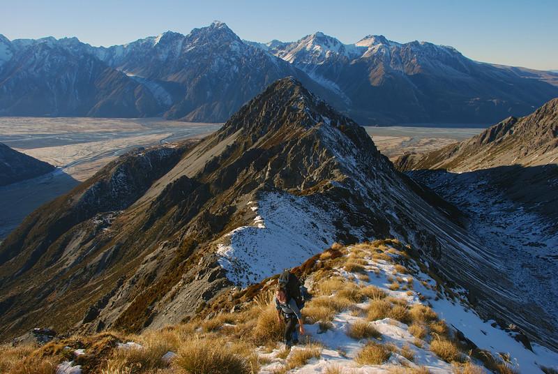 James on Sebastopol Ridge, just above Mt Sebastopol. The peaks on the horizon are Mt Blackburn, Mt German and Mt Burnett