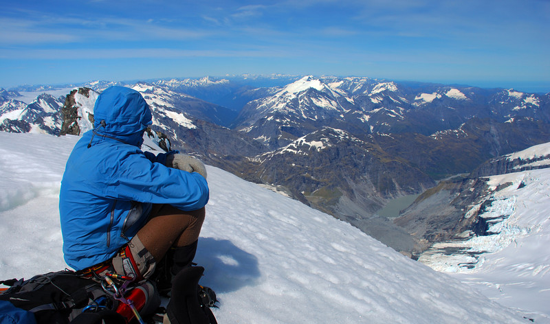 George on the summit of Mt Sefton, looking into the Landsborough, Karangarua and Douglas valleys