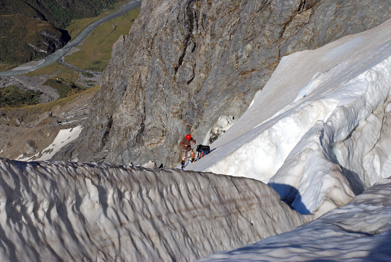 George coiling up the rope at the top of the steep section on the Wicks Glacier. Horace Walker Hut is visible as a white speck on the valley floor, 1000m below us.