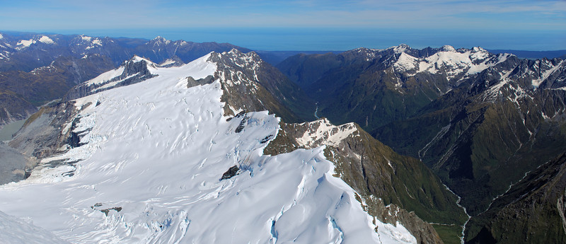 Looking west from the summit of Mt Sefton: Douglas Glacier and Lake, Sierra Range, Copland River and Tasman Sea. Even the Copland hot pools are clearly visible, if the photograph is enlarged to full size!