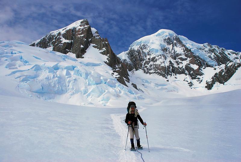 Snow shoeing down the Heemskerck Glacier. Lendenfeld Peak and Mount Tasman above