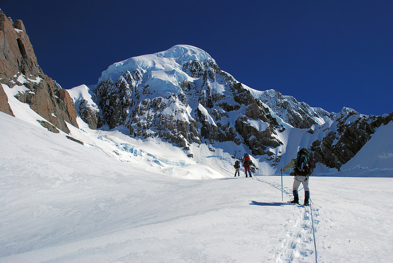 Snow shoeing up the Heemskerck Glacier. Mount Tasman dominates the scene