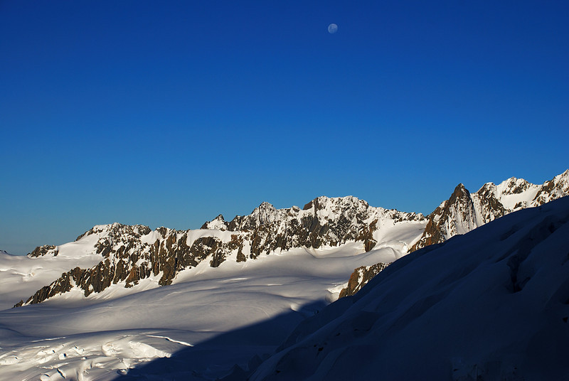 A nearly full moon over Pioneer Ridge and Mounts Mallory and Barnicoat