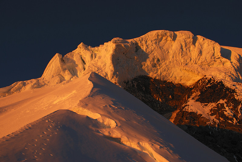 Looking up to Mount Tasman's North Shoulder at sun rise
