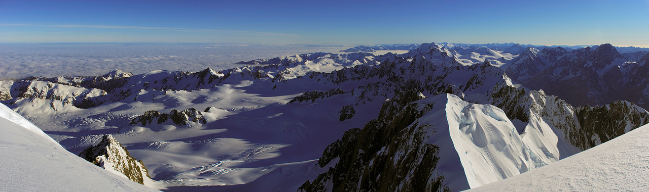 Panorama from Mount Tasman's North Shoulder. The two prominent peaks on the skyline are Mt Élie de Beaumont (dircetly above Lendenfeld Peak) and Malte Brun. The Albert Glacier occupies the left half of the image