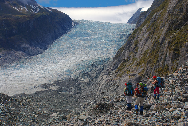 Approaching the end of the moraine at Vic Flat, below the second icefall on Fox Glacier. Chancellor Shelf top left