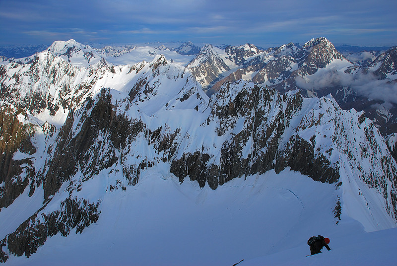 Descending Lendenfeld Peak at dusk. Mount Élie de Beaumont and Malte Brun are on the skyline