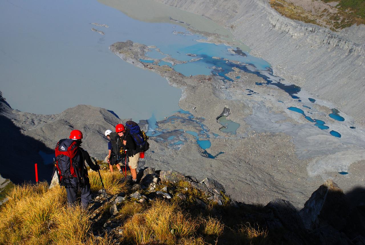 Descending from Sefton Biv. The terminal lake of the Mueller Glacier below