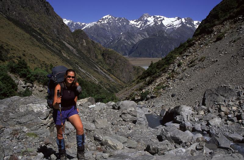 Jo walking up Gorilla Stream. Mt Edgar Thomson and Mt Sealy behind