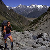 Jo walking up Gorilla Stream. Mt Edgar Thomson and Mt Sealy behind