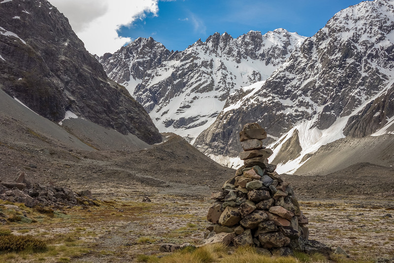 Cairn near Cameron Hut,a t the toe of the Carriage Way. Couloir Peak and Jagged Peak above