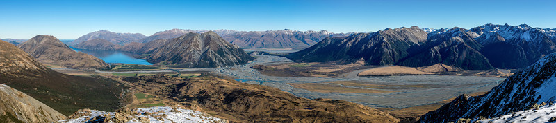 Panorama from The Spurs' west ridge. From left to right are Lake Coleridge, the Wilberforce River, Mount Arrowsmith (in the background), Turret Peak