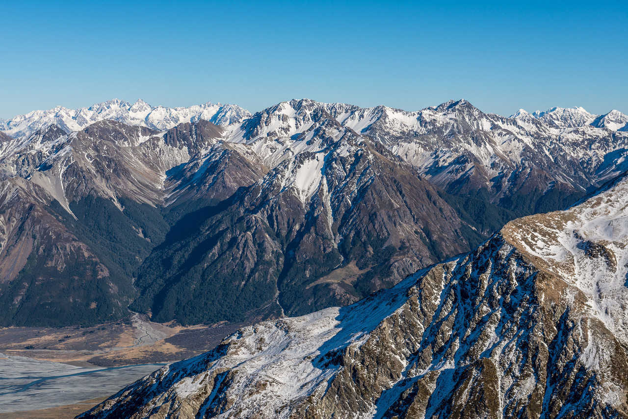 View from Pt 1850m, Birdwood Range: Mount Arrowsmith, Jagged Peak, Red Peak, North Peak (back left), Jacks Hill (at centre image), Mt Whitcombe (far right). Kakapo Stream flows into the Wilberforce River front left