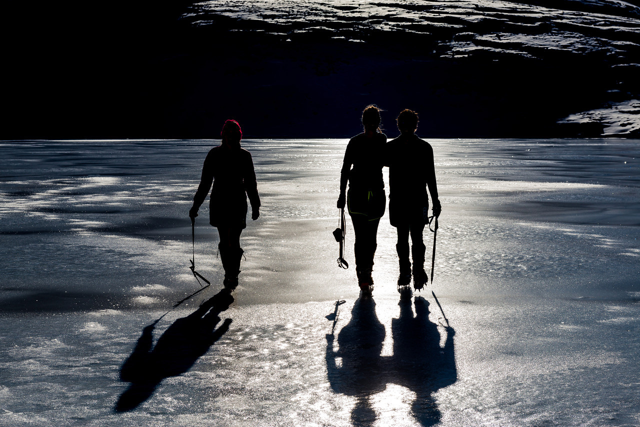 Walking across a frozen Casey Tarn