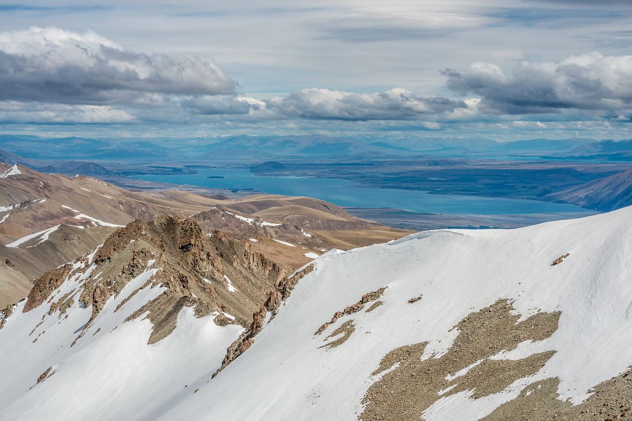 View of Lake Tekapo from Captains Peak. Motuariki Island is visible near the southern end of the lake.