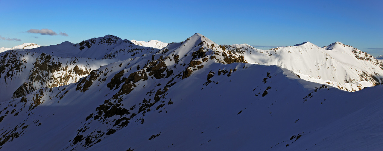 Looking south from the top of Hut Spur. Unnamed peak 1907m is in the foreground, Packard Peak (left) and Thesis Peak (right) are behind