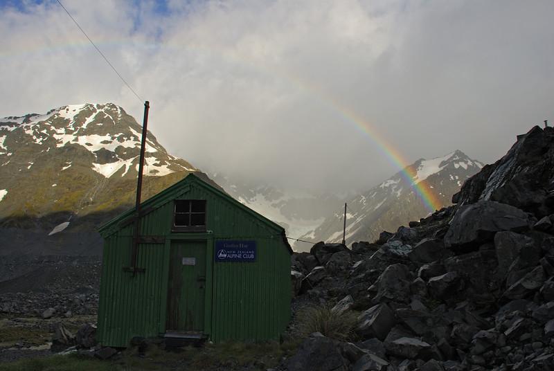 Rainbow over Godley Hut