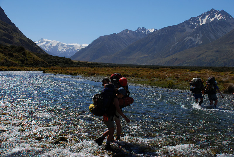 Fording a braid of the Rangitata River. McClure Peak (left) and the Cloudy Peak Range loom above