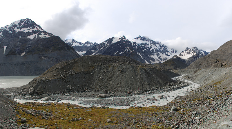 The Godley River between the lakes. Panorama, Gordon Peak and Mt Fletcher in the back. Cassino Peak, Alamein Peak and Takrouna Peak are just visible above the valley of the Grey Glacier.