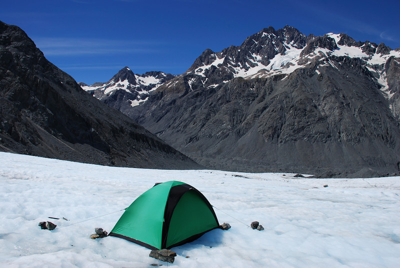 Campsite on the Godley Glacier. The Commander, Mt D'Archiac and the Trident Glacier in the back.